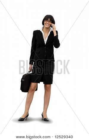 Portrait of a smiling businesswoman with a phone and a suitcase