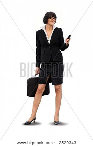 Portrait of a smiling businesswoman with a phone and suitcase