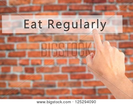 Eat Regularly - Hand Pressing A Button On Blurred Background Concept On Visual Screen.