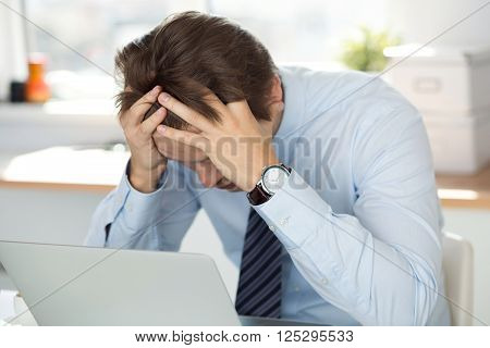 Tired Businessman Sitting At Office