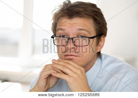 Portrait Of Frustrated Business Man Wearing Glasses