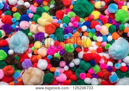 multi coloured fluffy pompoms of all sizes large and small