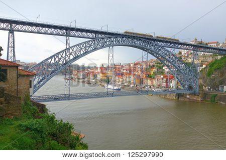 Bridge of Don Luis I across the river Douro in Porto. Gloomy rainy day
