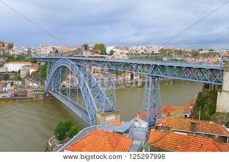 Bridge of Don Luis I across the river Douro in Porto. Rainy day