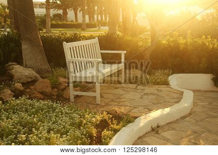 a very nice bench in the park
