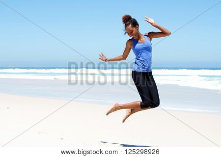 Sporty Woman Jumping At The Beach