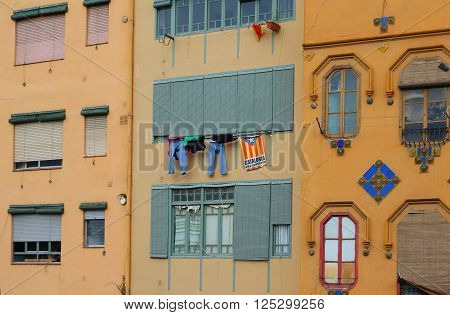 Detail of the facade of houses in Girona. Residential house in Catalonia