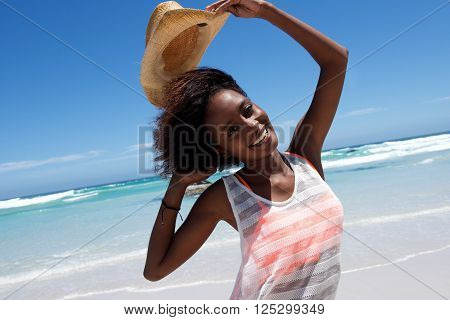 Cheerful Young African Woman At The Beach