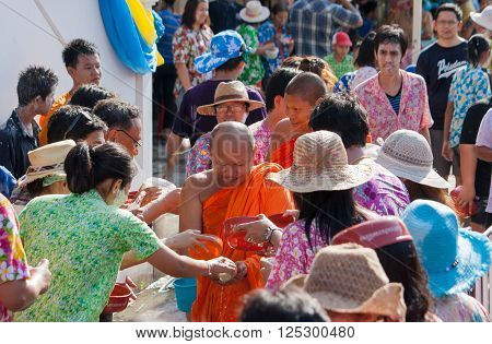 Nonthaburi - April 4, 2011  Songkran festival or cultural traditions  Philanthropy New Year Thailand  outdoors Pour water  According to tradition. Buddhist monks  and congregants Wat Poramaiyikawas Worawihan, Pak Kret, Thailand
