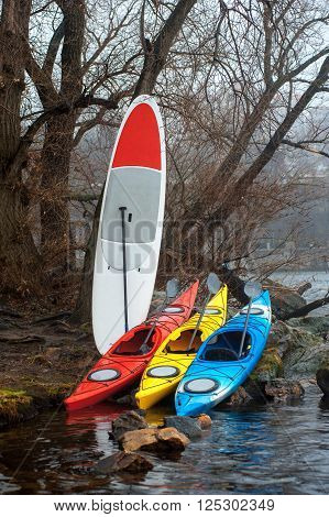 Colorful Fiberglass Kayaks Lying On The Rocky Shore02