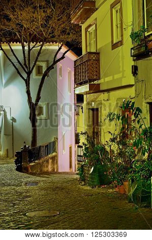 Alfama street at night in Lisbon Portugal