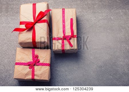 Festive gift boxes on grey slate background. Selective focus. Place for text.