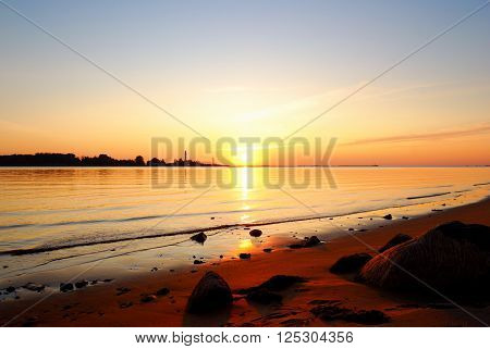 Colorful sunset at the sea shore. Beach of Riga