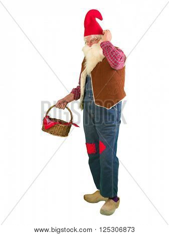 Funny garden gnome on white holding a wicker basket