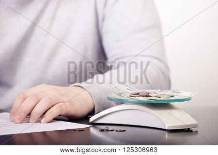 Business adviser analyzing financial figures denoting  progress in the work of the company. ** Note: Shallow depth of field