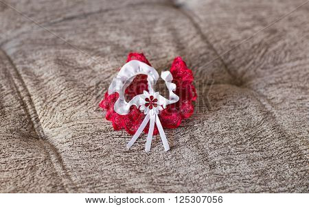 Beautiful wedding white bridal garter. Wedding day moments