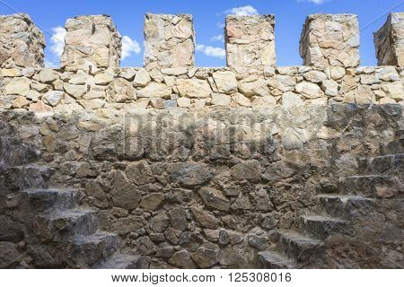 fort wall medieval stone tower in the city of Toledo, Spain, ancient fortification