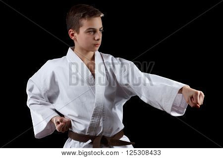 Karate Fighter in white Kimono Isolated on Black with Copyspace