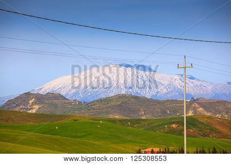 View of Etna volcano and Sicily field