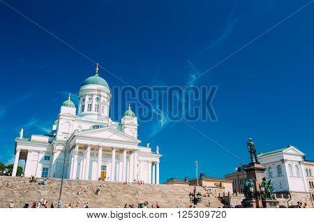 HELSINKI, FINLAND - JULY 28, 2014: Helsinki Cathedral, Helsinki, Finland. The Facade Fronted By A Statue Of Emperor Alexander II Of Russia. Travel landmark