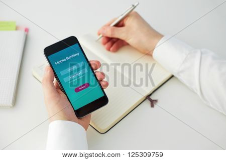 Male Holds In His Hand A Cell Phone And Writes In Your Diary