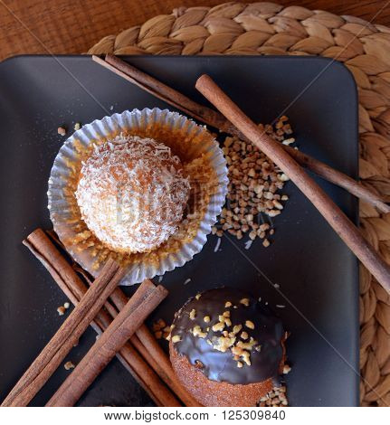 Fresh Homemade Vanilla Muffins With Chocolate And Grated Coconut.