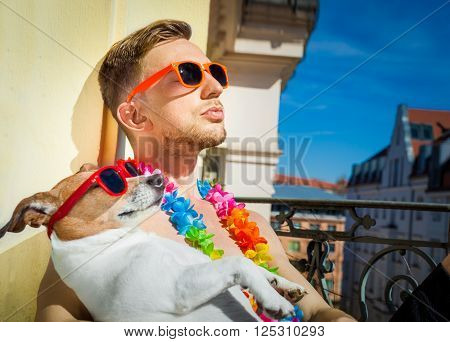 jack russell dog and owner having a siesta under the sun sun tanning with sunglasses close and cozy together in love