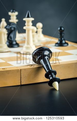 Black chess queen defeated