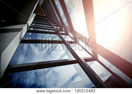 Modern business architecture and sunny sky. Construction with windows. Financial economics future etc. concept.