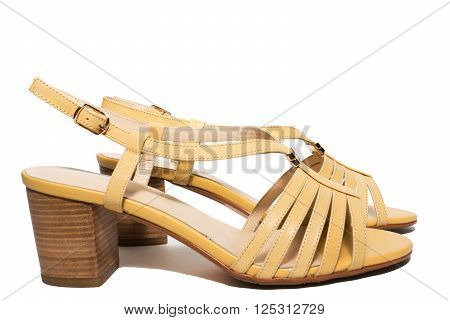 The photo shows women's shoes on a white background