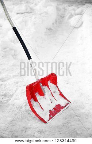 Red plastic shovel for snow