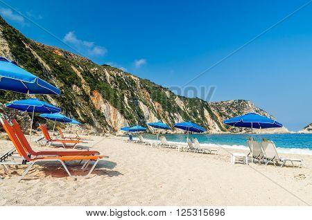 Sunbeds and umbrellas (parasols) on Petani beach, Kefalonia Island, Greece
