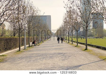 Brescia, Italy - April 03, 2016 - Tree lined avenue in city park in northen Italy