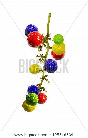 Blue red green and yellow grapes on white background