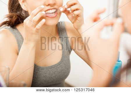 Putting A Whitening Strip On Her Teeth