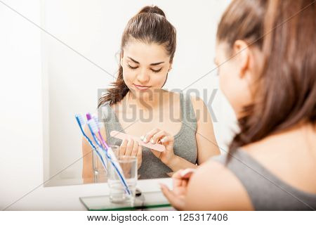 Pretty Girl Filing Her Nails