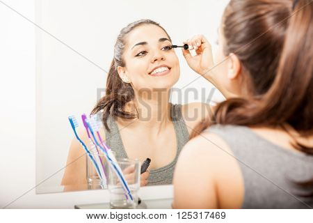 Cute Girl Putting On Some Makeup