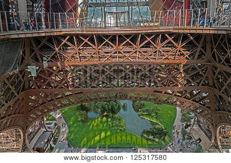 PARIS FRANCE - OCTOBER 10 2015: View from the first floor of the Eiffel tower tower at tourists and landscape on the ground.