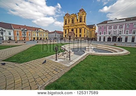 TIMISOARA ROMANIA - MARCH 18 2016: View of one part at Union Square in Timisoara Romania with old buildings and mineral fountain.