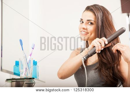 Woman Straightening Her Hair With Iron