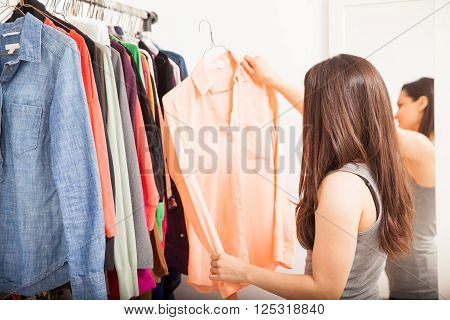 Woman Buying Clothes At A Sale