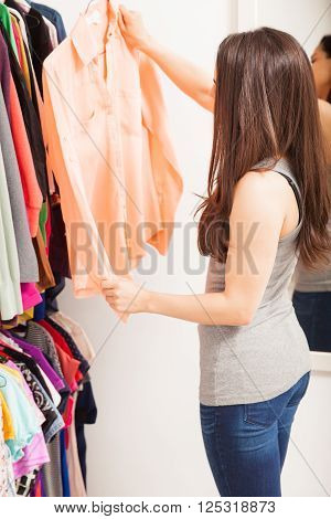 Pretty Brunette In Front Of A Closet