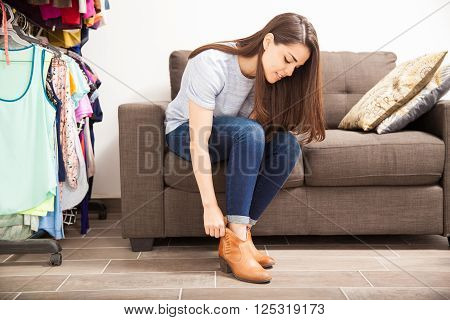 Putting Shoes On In A Dressing Room
