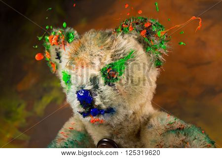 Colorful teddy bear with paint on it flying around