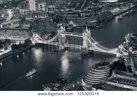 London aerial view panorama at night with urban architectures and Tower Bridge in BW.