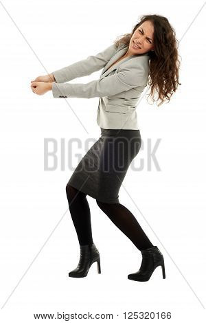 Latin Businesswoman Pulling An Imaginary Rope