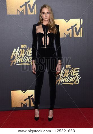 LOS ANGELES - APR 09:  Cara Delevingne arrives to the Mtv Movie Awards 2016  on April 09, 2016 in Hollywood, CA.