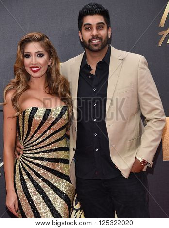 LOS ANGELES - APR 09:  Farrah Abraham & Simon Saran arrives to the Mtv Movie Awards 2016  on April 09, 2016 in Hollywood, CA.