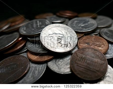US money coins pile on black background