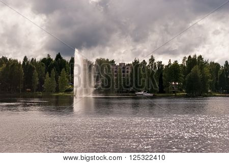 Artificial fountain on the water surface in the Finnish town of Heinola.